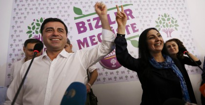 Co-chairs of the pro-Kurdish Peoples' Democratic Party (HDP), Demirtas and Yuksekdag celebrate inside party's headquarters in Istanbul